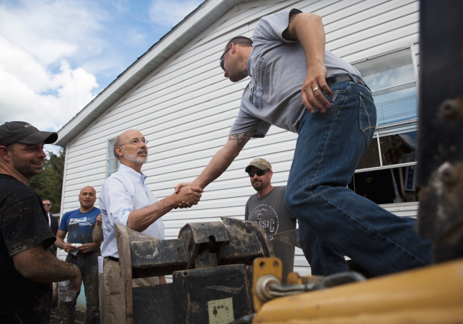 Pennsylvania Governor, Tom Wolf shakes hands with Tom Reagen of Dunbar Twp. during his visit to Connellsville. Photo credit: Herald-Standard
