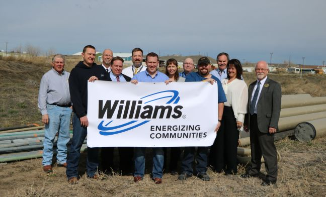 Group photo with Williams banner