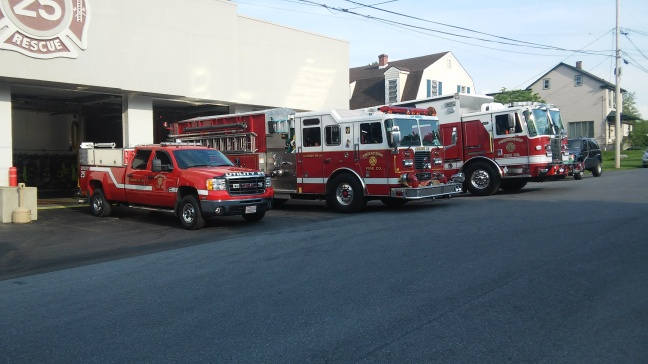 Photo of fire trucks and fire station