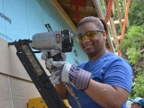 Tulsa employees build Habitat house to support colleague