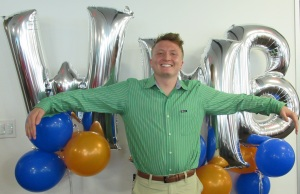 Intern Andrew with WMB balloons